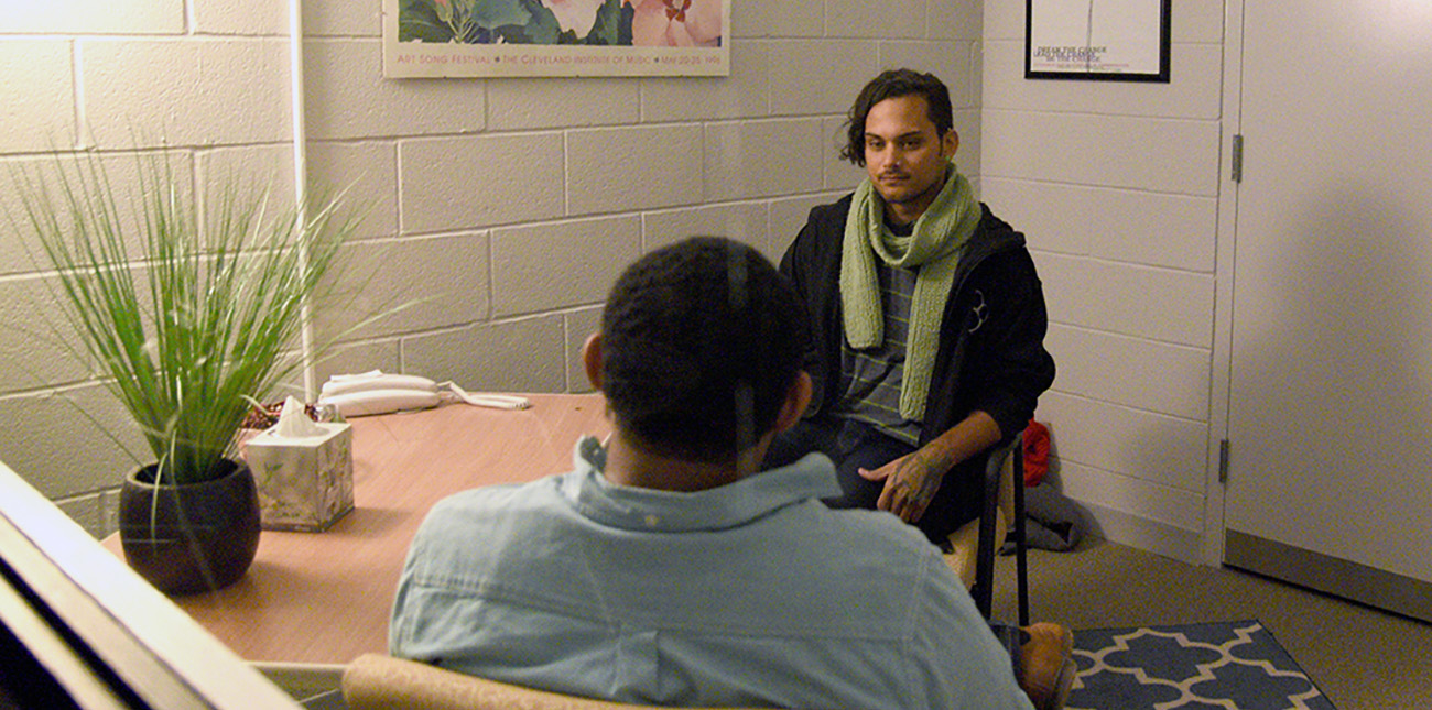 Two men having a discussion during a counseling session