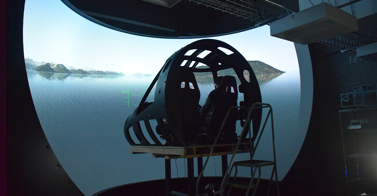 Person in cockpit of a flight simulatior