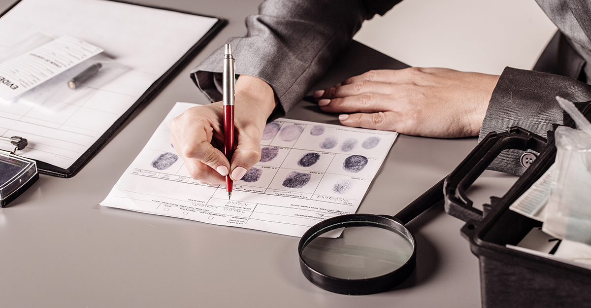 Individual reviews evidence and fingerprint document