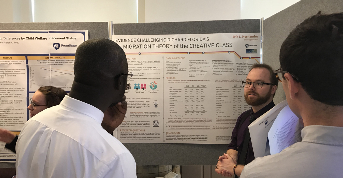 This was a photo taken at the 5th mini-PAA conference poster session in April, 2018. The mini-PAA is an annual event where Demography graduate students presenting at the annual meeting of the Population Association of America have the opportunity to practice their talk/ poster skills in a formal setting.