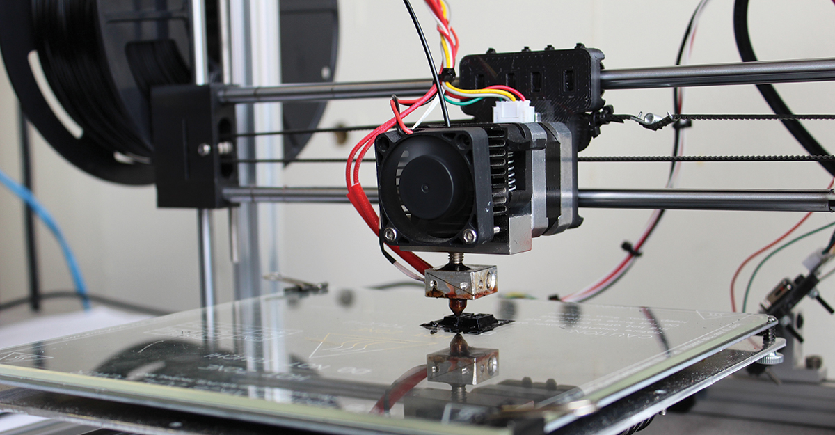 Close up of 3D printer creating a component for an experiment