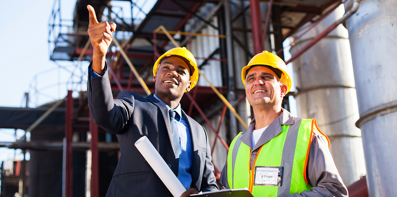 Two individuals discussing project on job site