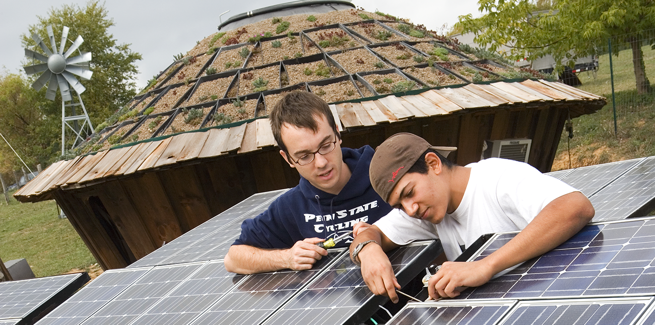Two students working on solar panels