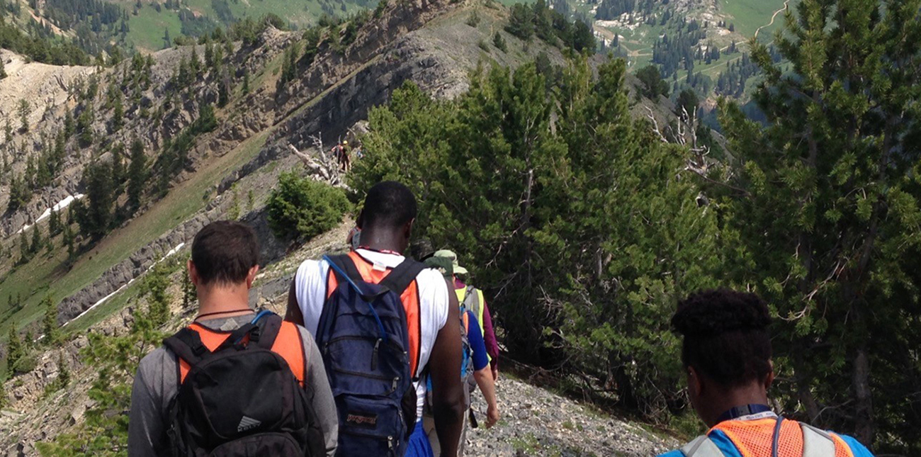 Students hiking down mountain