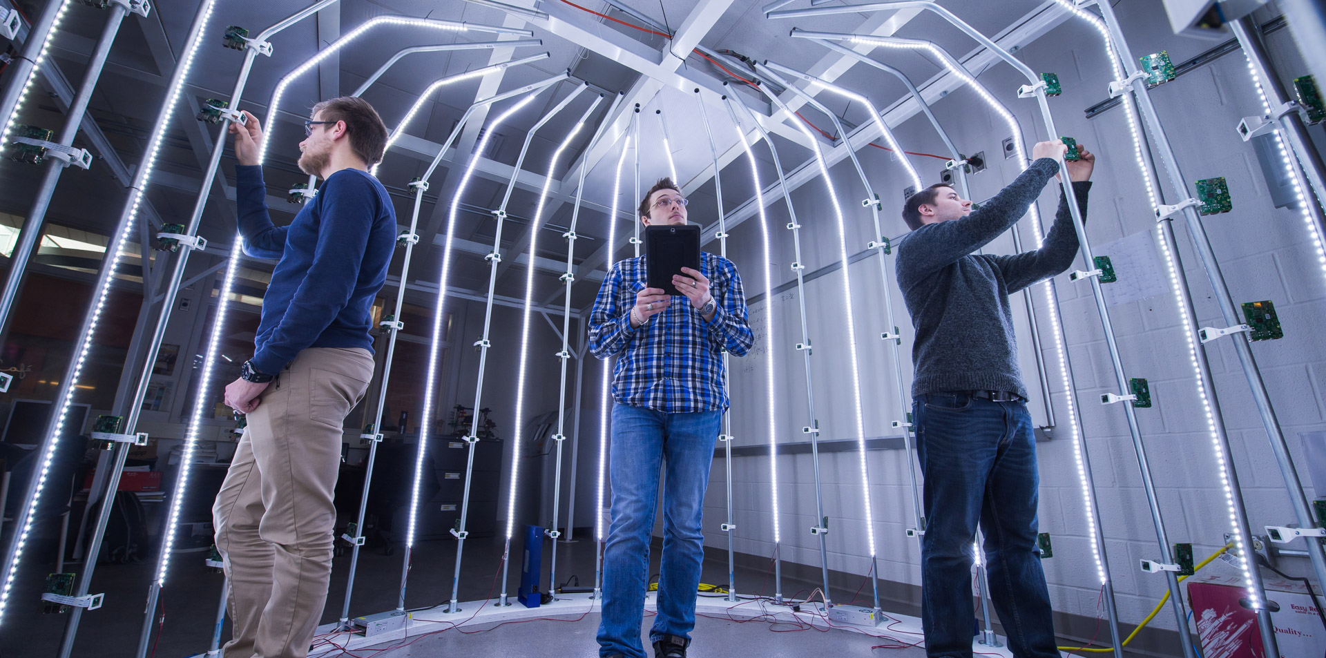 Students inside a brightly lit camera cage in Behrend's Innovation Commons