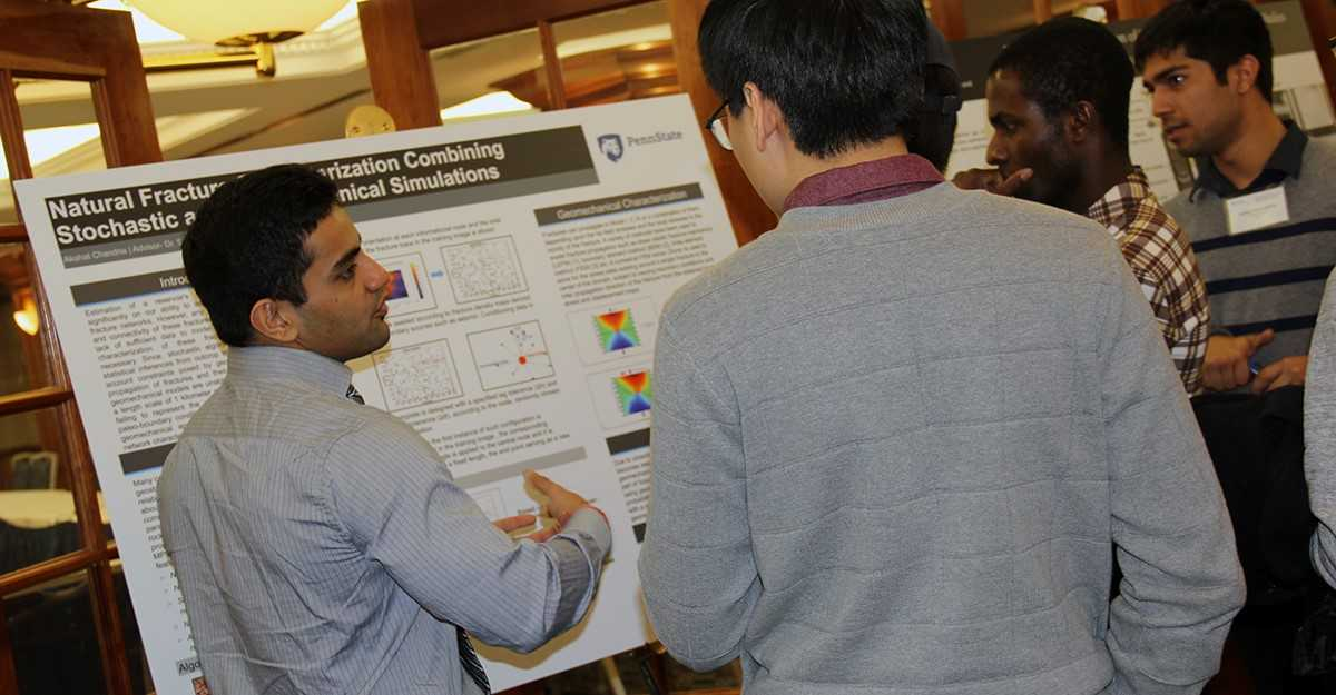 EME graduate students discussing their EME research with the public during a poster session.