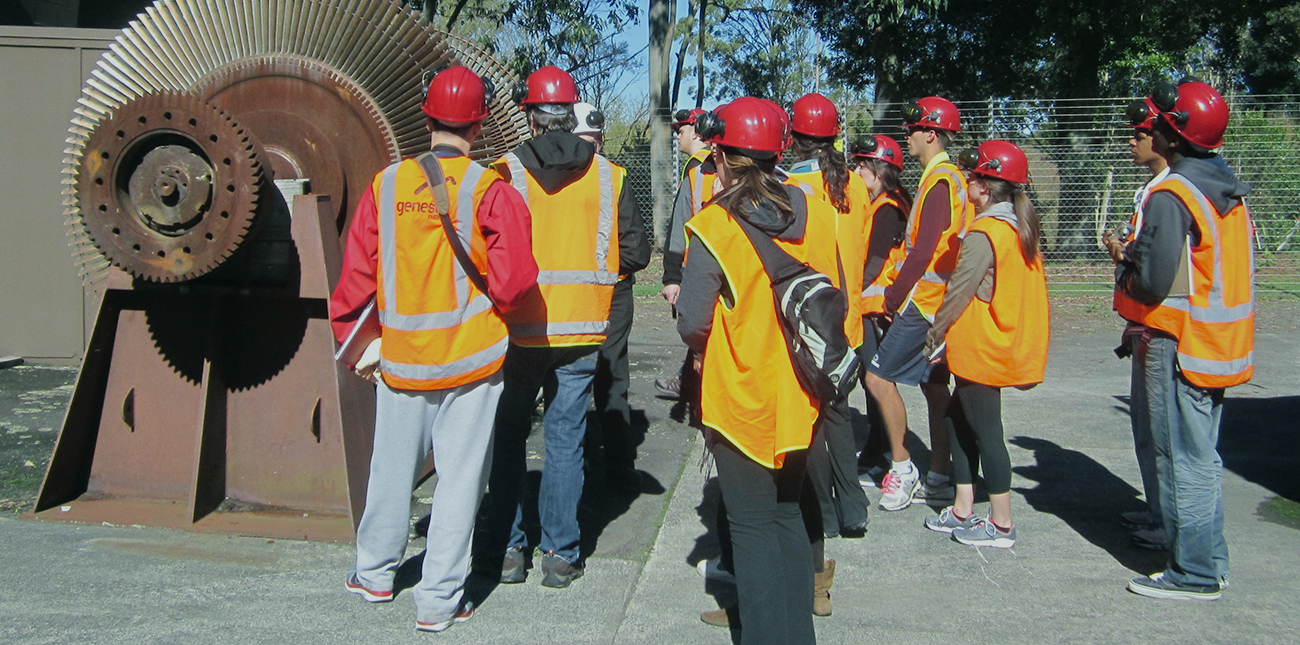Group of students gathering around energy equipment in New Zealand