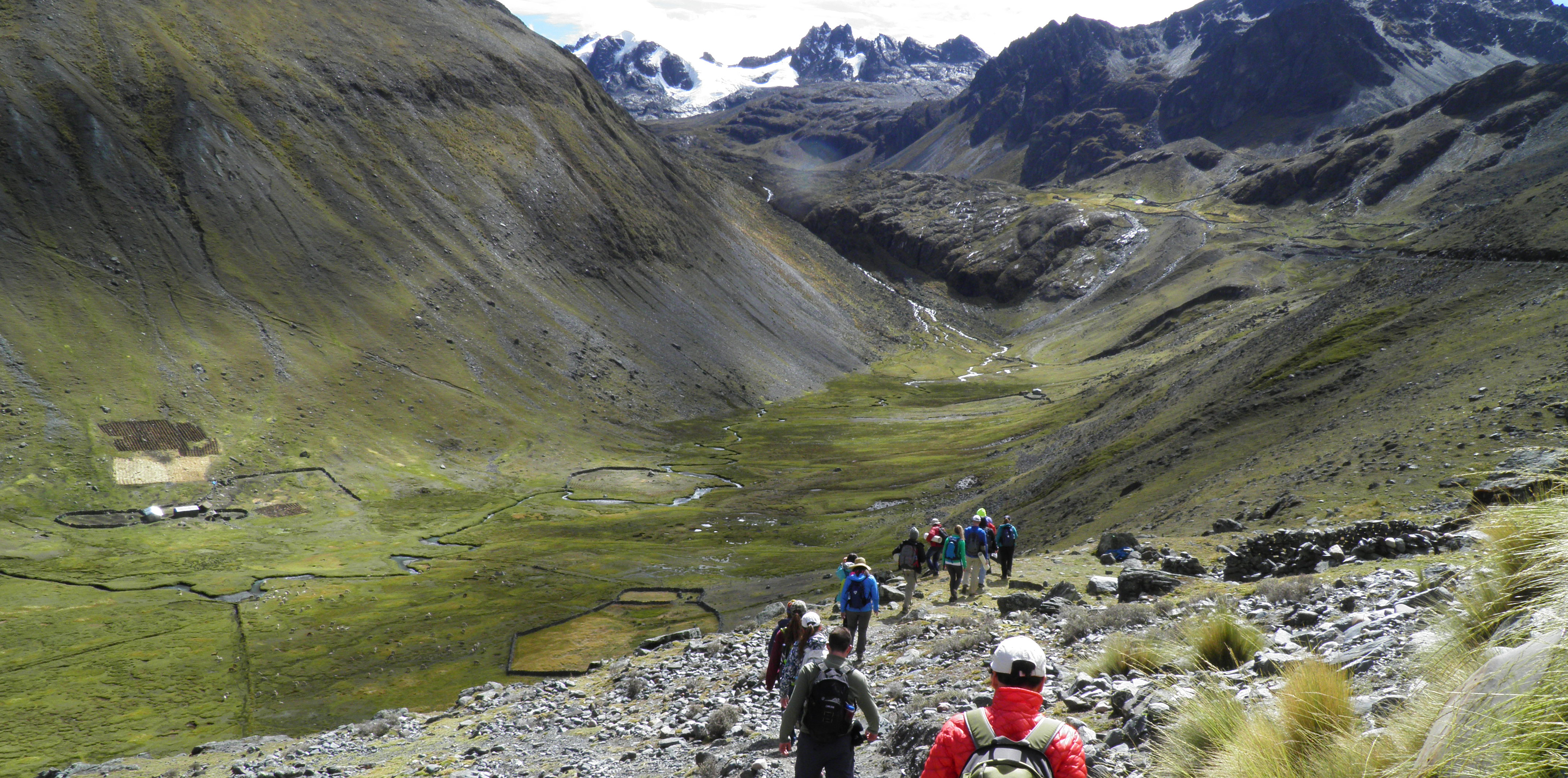 Students trekking down mountainside on trip to Peru