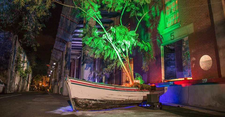 Installation by Nirveda Alleck, titled The Migrant's Tale, Mauritius, 2017. Photograph by Chiranjiv Mahesh Kumar Aungnoo. The installation is of a boat with a  tree growing out of it and represents the Department of French and Francophone Studies' commitment to exploring visual studies, global studies, African studies, women's, gender, and sexuality studies, cultural studies and literature.