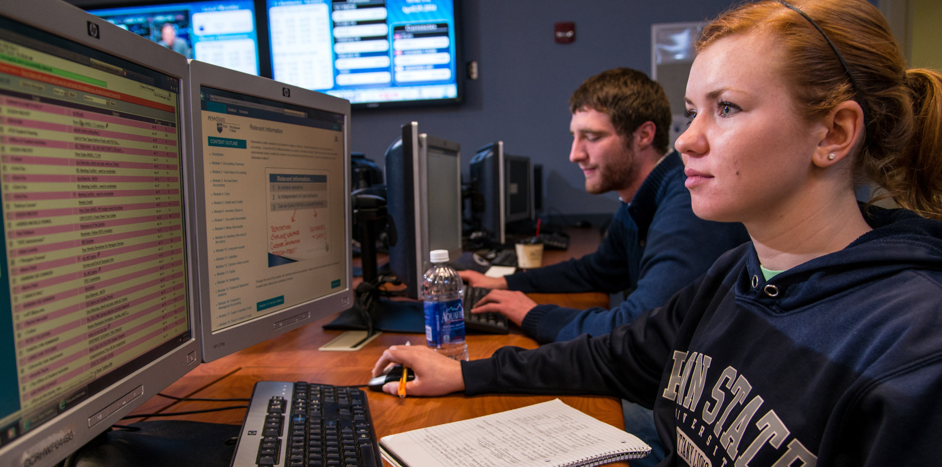 Student sitting at a dual-screen computer in Behrend's simulated trading floor lab