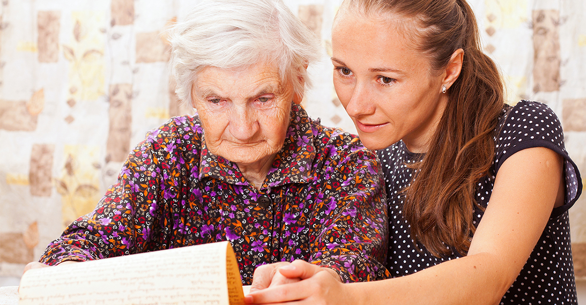 Gerontology student helping an older adult.