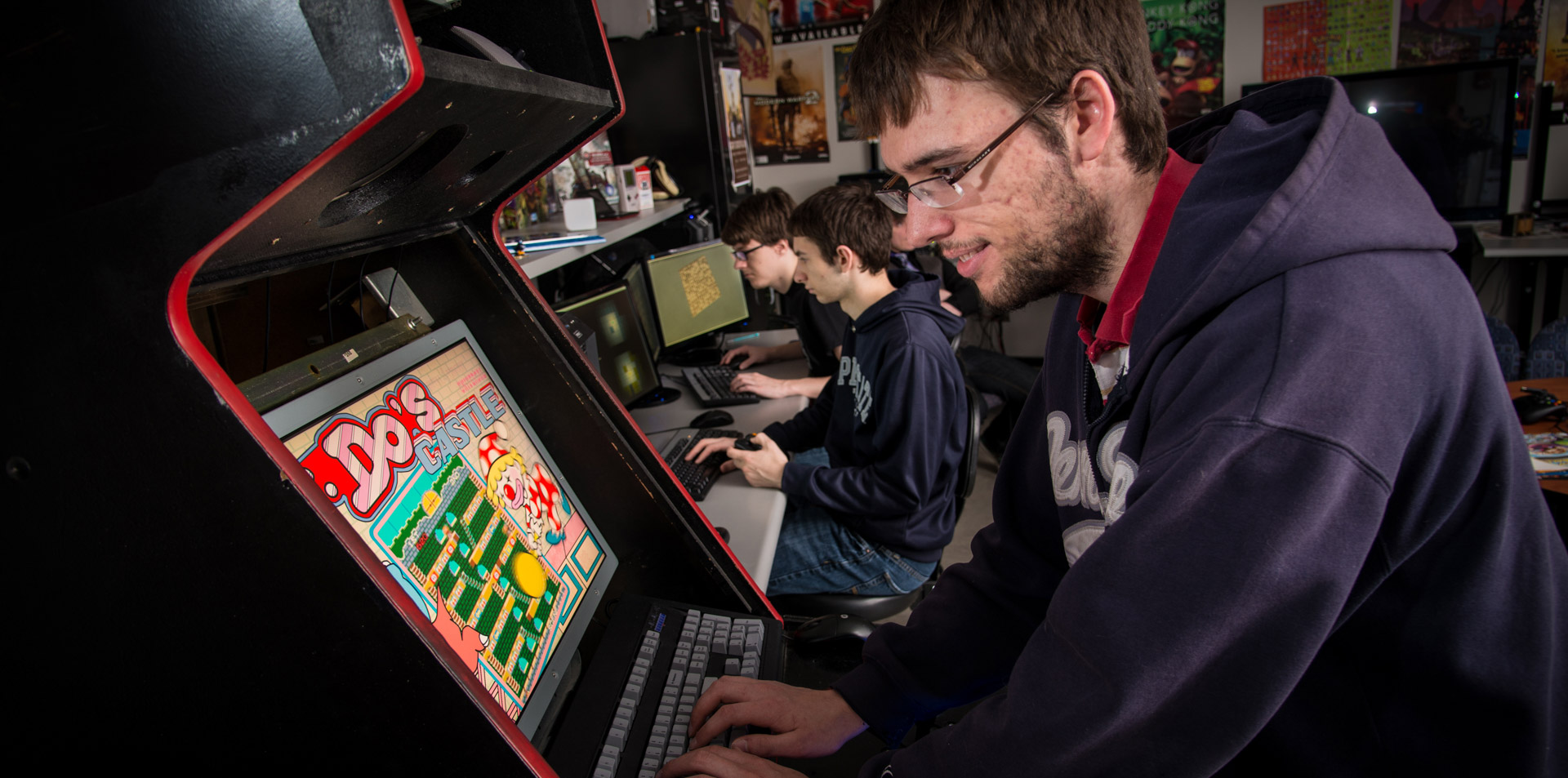 Student playing Do's Castle console video game in Behrend gaming lab