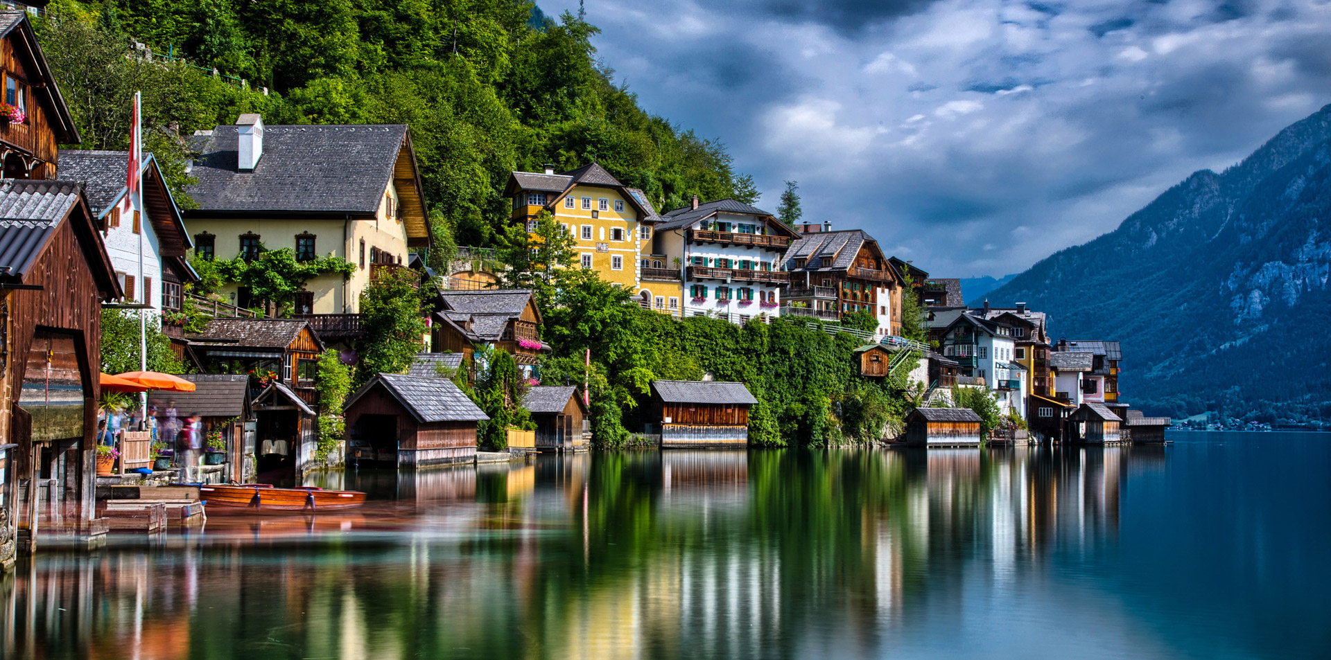 Scenic Austrian town with lake in foreground and mountains in background