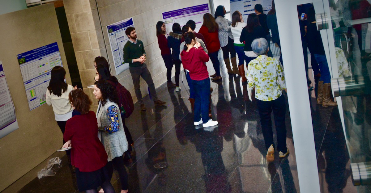 Graduate students present research and discuss their work