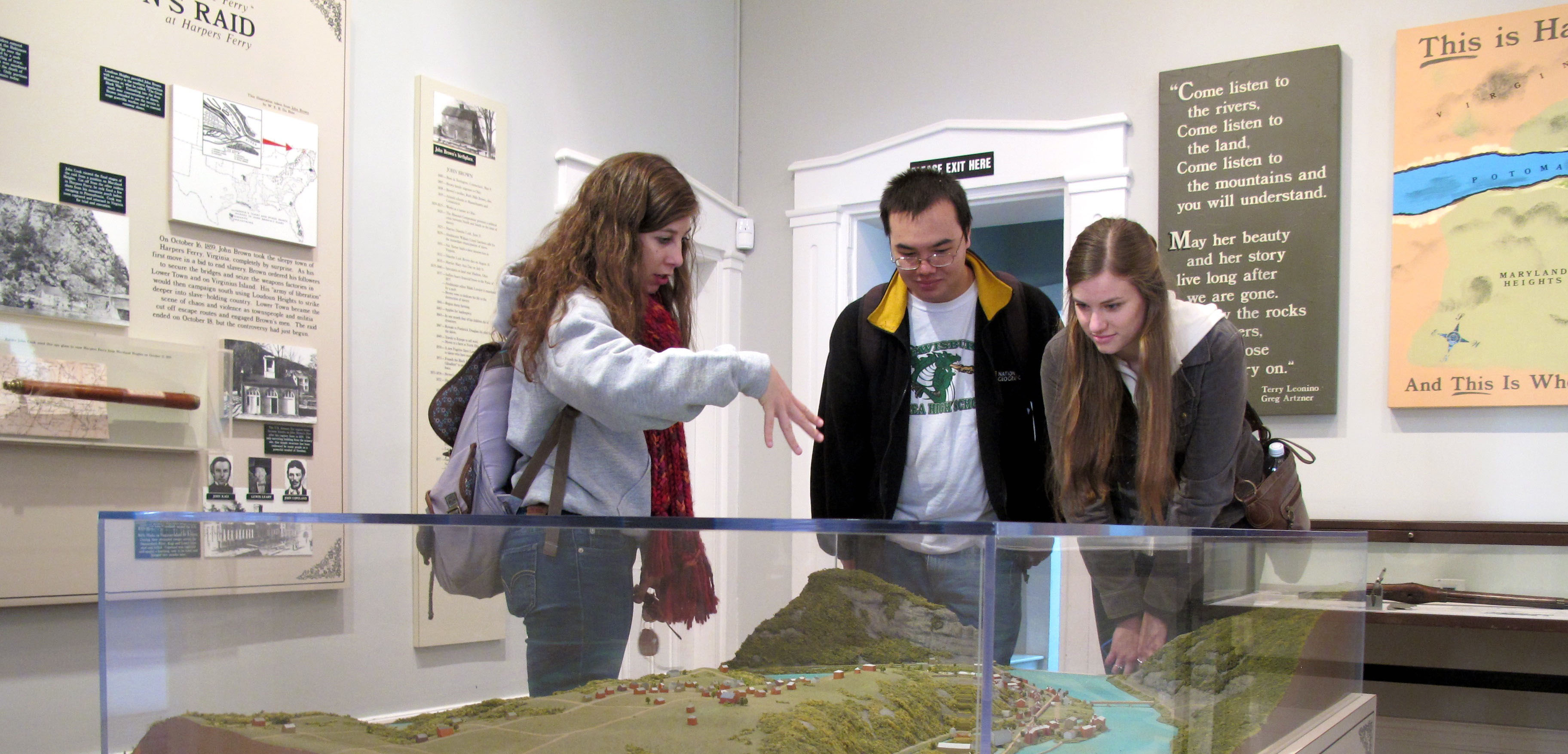 Students viewing scale model of rural town