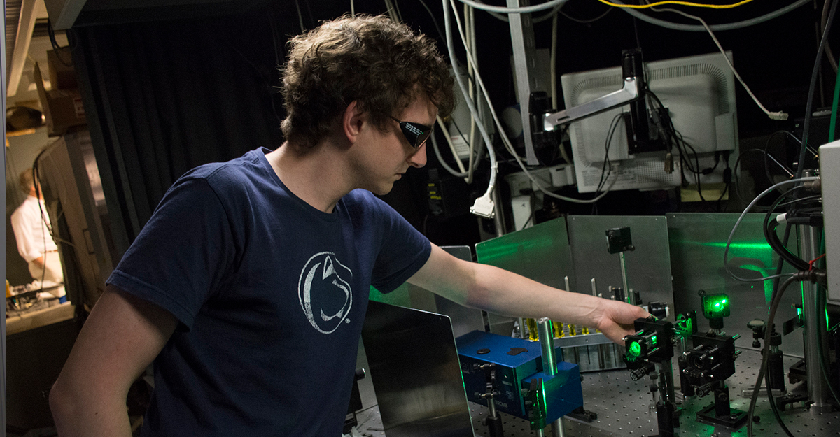 Student working in laser lab on an experiment