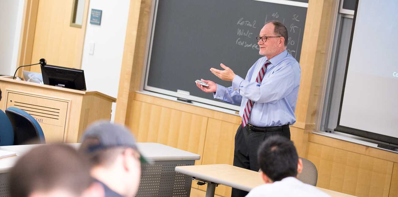 Professor Jeff Sharp addressing students during a class lecture