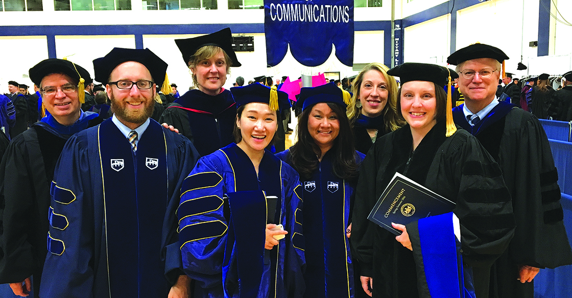 Photograph of Communications graduate faculty and graduating Ph.D. students