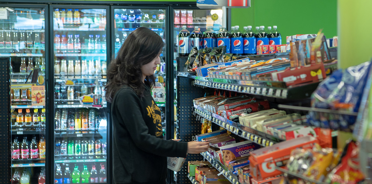 Behrend student shopping in on-campus convenience store