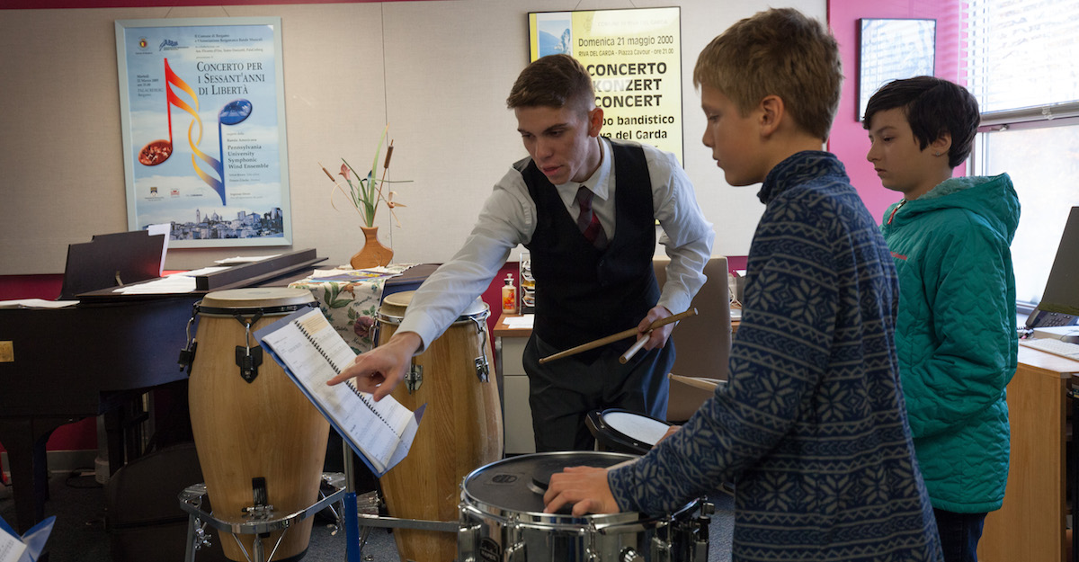 A music education student works with young musicians.