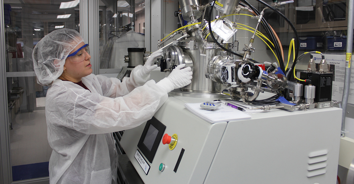 Technician working on industrial nanotechnology machine