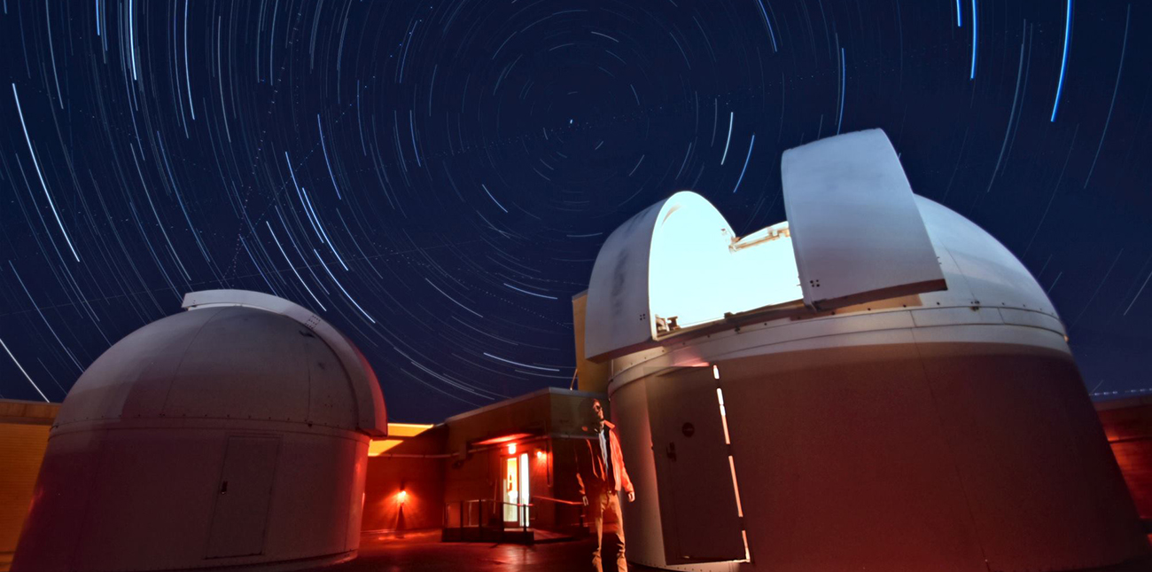 Timelapsed nighttime view of telescopes on the roof of Davey Lab