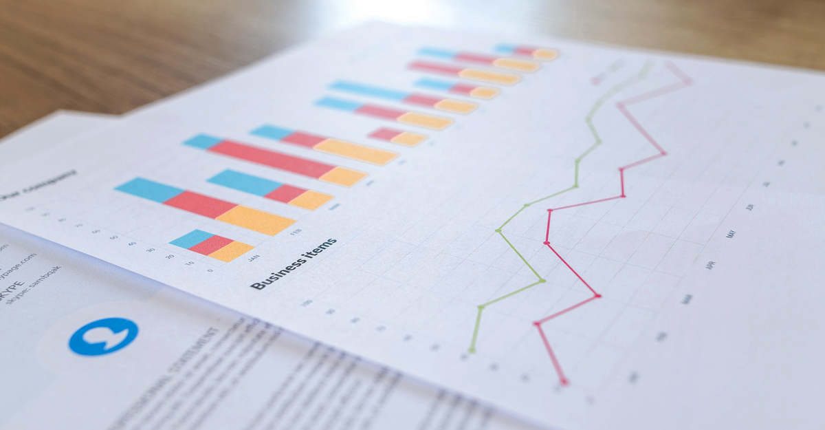 Stack of business graphs and charts