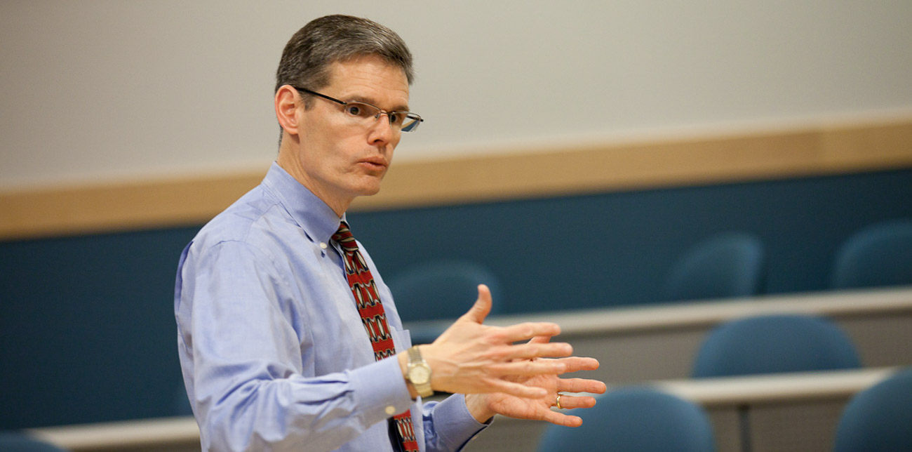 Professor Brent Ambrose addressing students during a class lecture