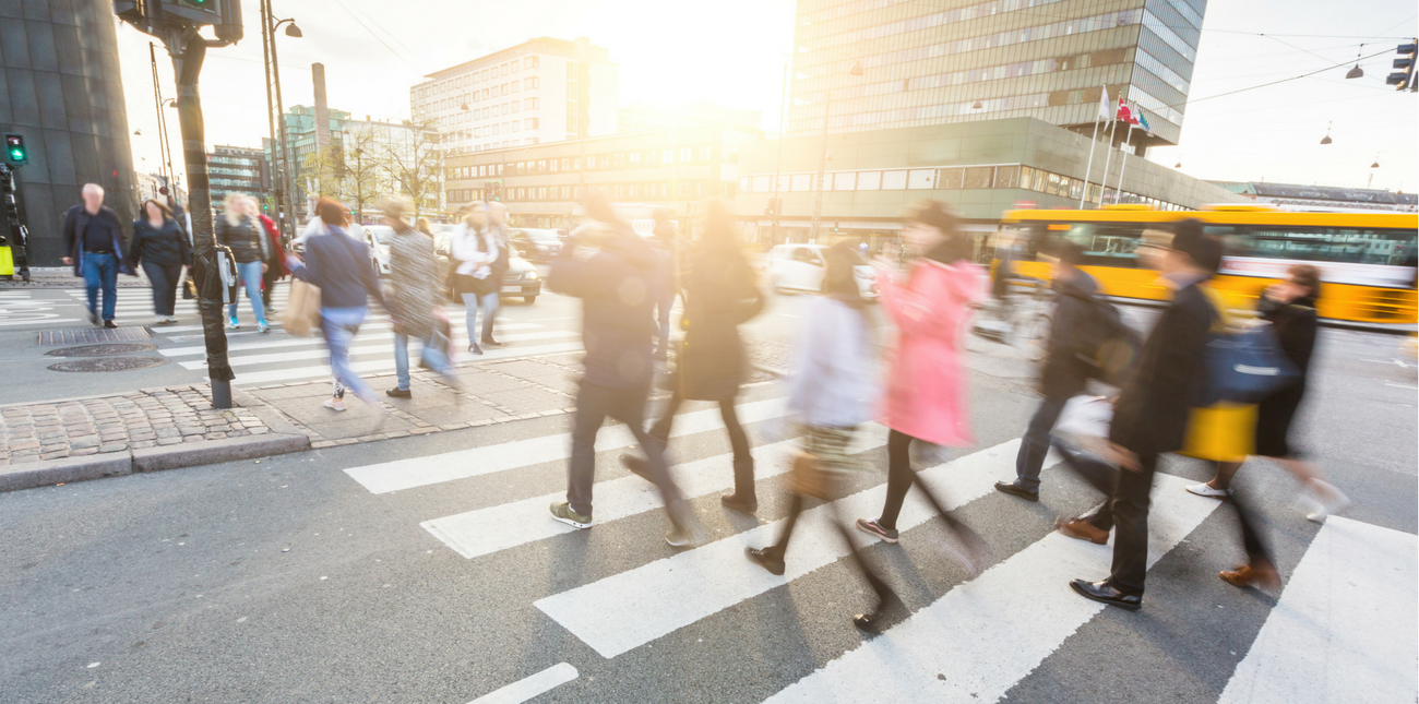 People crossing the street in a busy city
