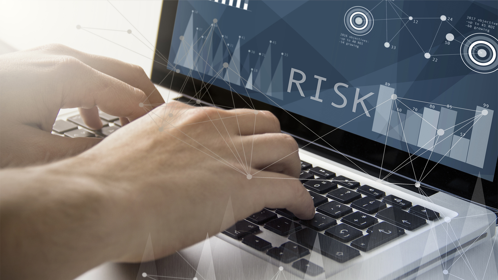 Individual typing on laptop that is displaying risk analytics
