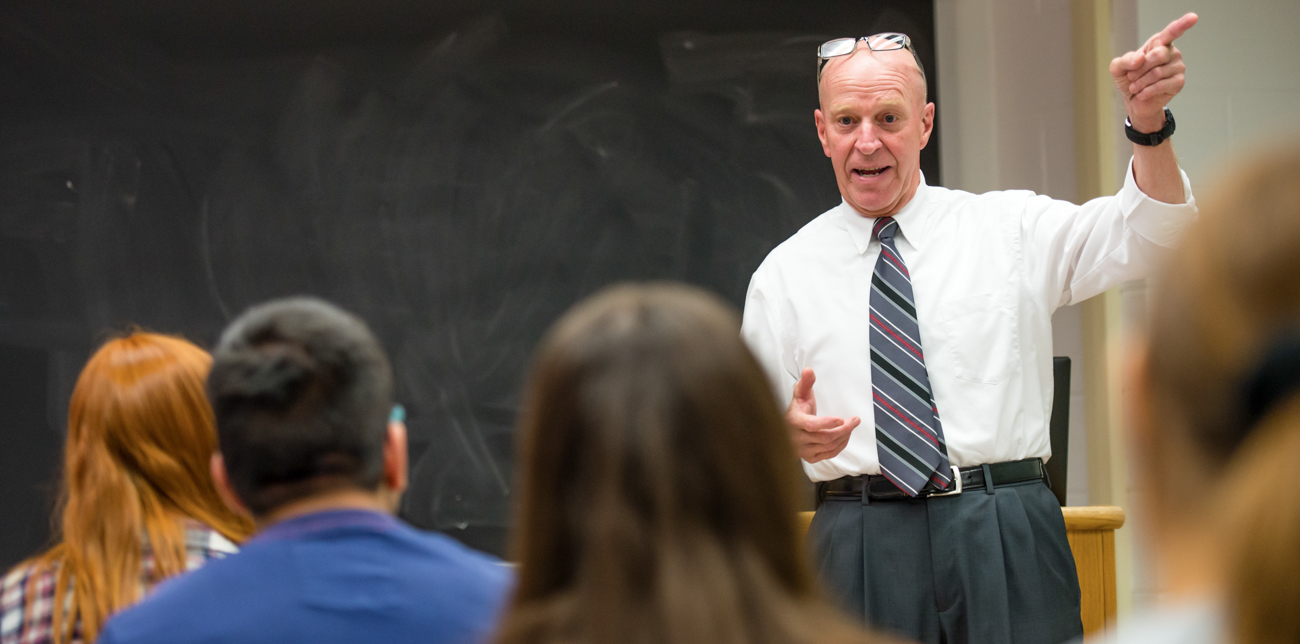 Professor Bob Novack addressing students during a class lecture