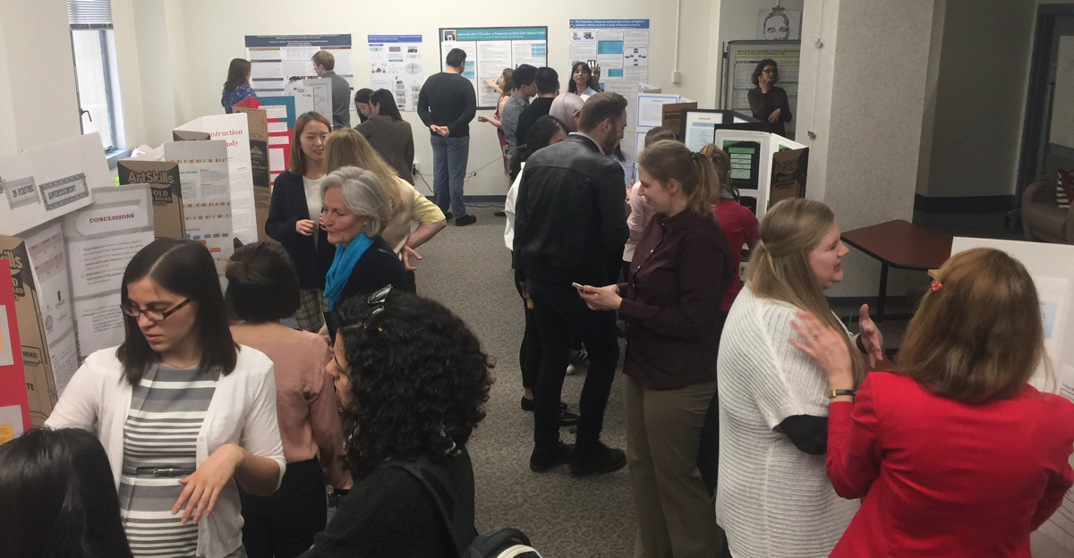 Photo is from the Spring 2018 APLNG Open House during which graduateing MA TESL students are required to present a poster on their MA Paper topic.