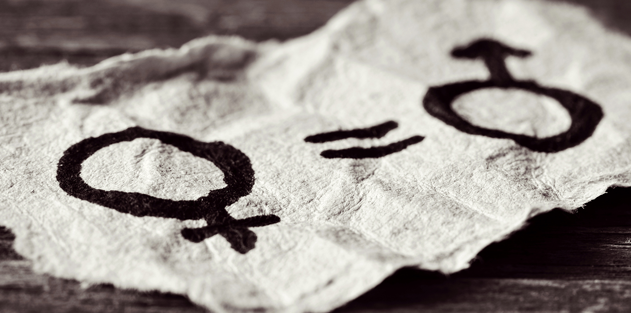Piece of fabric with gender symbols and an equal sign