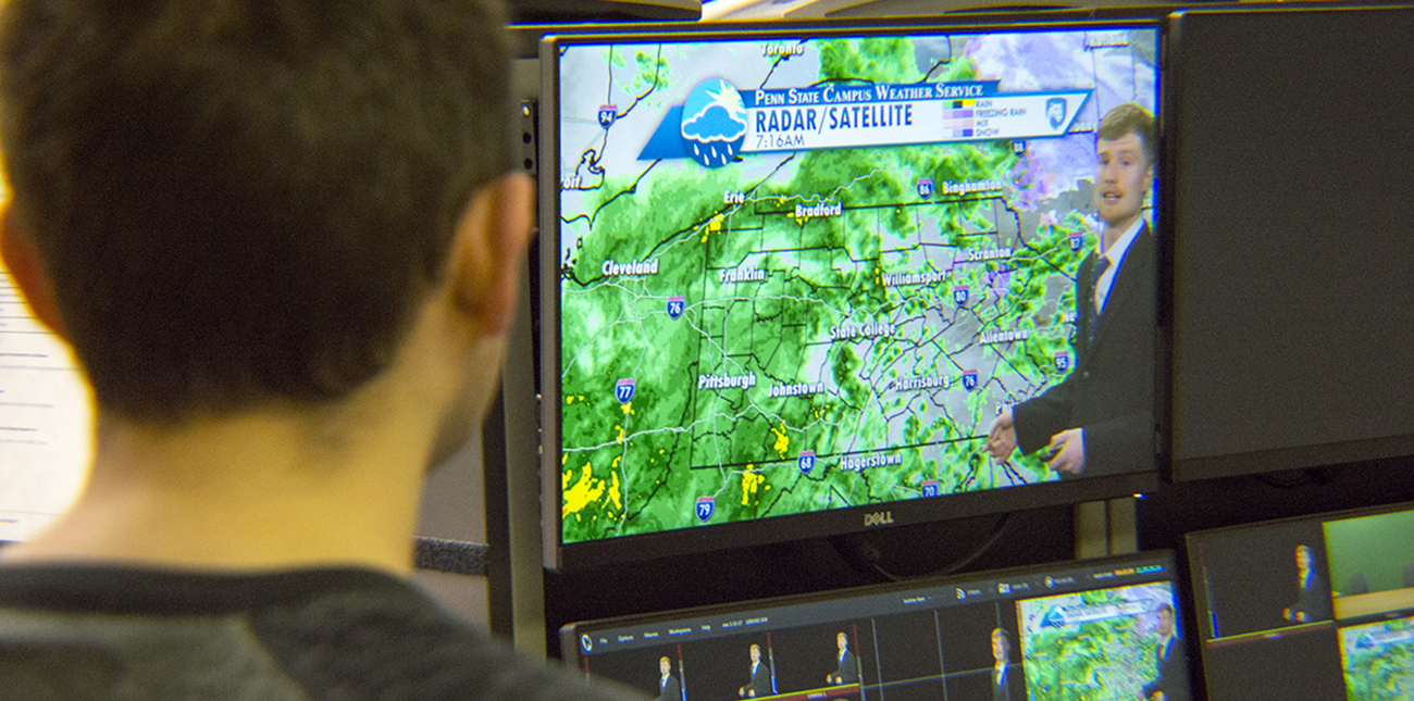 Campus Weather Service students delivering on air weather forecast