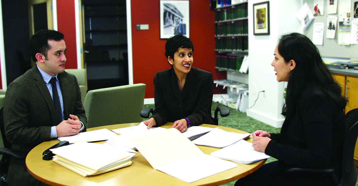 Professor Shoba Wadhia reviewing notes with students